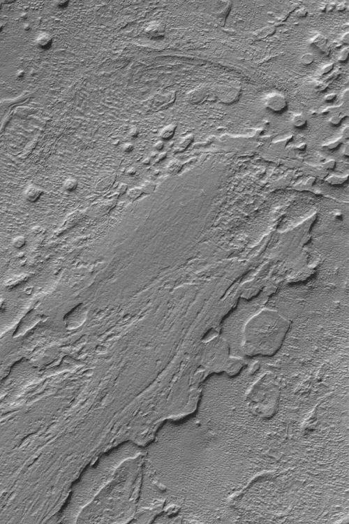 Bodenerosion im Hellas-Becken (Courtesy of NASA / JPL / MSSS)