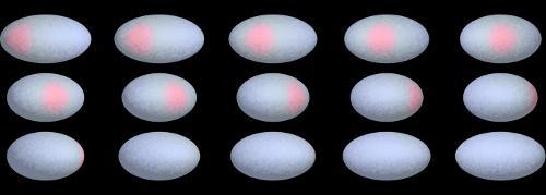 Computergenerierte Bilder des Zwergplaneten Haumea und des dunklen, roten Flecks (Pedro Lacerda)