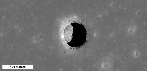 """Mare Tranquillitatis Pit"" (Courtesy of NASA / GSFC / Arizona State University)"