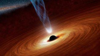 Illustration eines supermassiven Schwarzen Lochs im Zentrum einer Akkretionsscheibe. Ein Anteil der einfallenden Materie wird in Form eines bläulichen Jets abgestoßen. (NASA / JPL-Caltech)