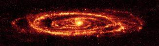 Infrarotaufnahme der Andromeda-Galaxie M31. Das Bild basiert auf Daten des Weltraumteleskops Spitzer und lässt komplexe Staubstrukturen innerhalb der riesigen Galaxie erkennen. (NASA / JPL-Caltech / Univ. of Ariz.)