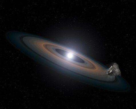 Künstlerische Darstellung von Gesteinstrümmern in Umlaufbahnen um einen Weißen Zwerg. (NASA, ESA, STScI, and G. Bacon (STScI))