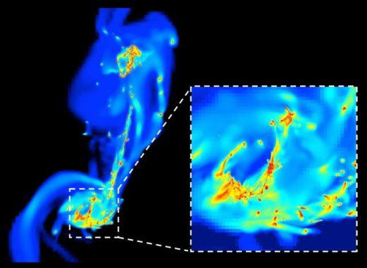 Ein Einzelbild aus der Simulation der beiden kollidierenden Antennengalaxien. Die hohe Auflösung erlaubt den Astrophysikern die Untersuchung kleinster Details. In den dichtesten Regionen (gelb und rot) entstehen neue Sterne unter dem Einfluss komprimierender Turbulenzen. Die Entstehung von Sternen ist hier effizienter als in normalen Galaxien wie der Milchstraßen-Galaxie. (F. Renaud / CEA-Sap)