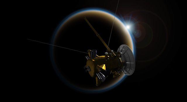 Künstlerische Darstellung der NASA-Raumsonde Cassini bei der Beobachtung eines Sonnenuntergangs durch die dunstige Atmosphäre des Saturnmondes Titan. (NASA / JPL-Caltech)