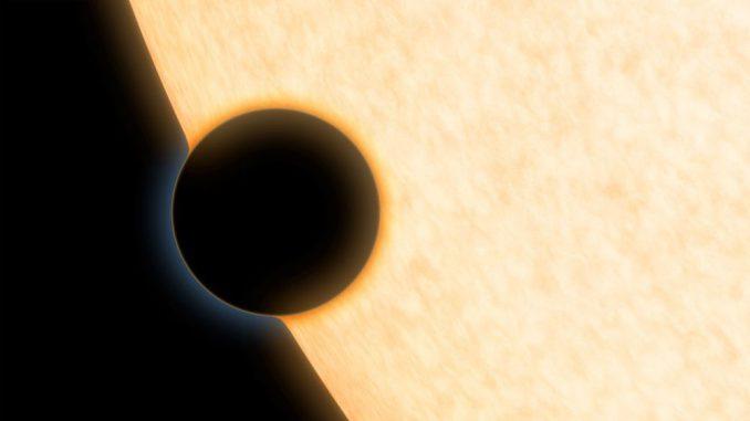Diese Illustration zeigt die Silhouette des Exoplaneten HAT-P-11b vor seinem Zentralstern. Der Exoplanet wurde bei einem Transit beobachtet, um mehr über seine Atmosphäre zu erfahren. (NASA / JPL-Caltech)
