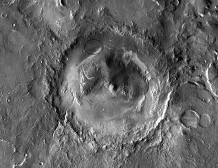 Der Gale-Krater auf dem Mars. Es scheint so, als hätte fließendes Wasser Kanäle an den Kraterwänden geschaffen. Der Curiosity-Rover landete am Fuß eines Schichtberges innerhalb dieses großen Kraters. (NASA / JPL-Caltech)