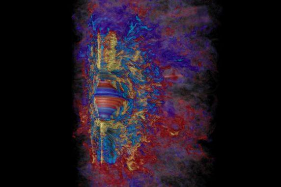 Simulation des toroidalen Magnetfeldes in einem kollabierten, massereichen Stern. Die schnelle, differentielle Rotation verstärkt das Magnetfeld binnen 10 Millisekunden auf das eine Million Milliardenfache des Sonnenmagnetfeldes (gelb ist positiv, hellblau negativ). Rot und Blau repräsentieren schwächere positive und negative Magnetfelder. (Robert R. Sisneros (NCSA) and Philipp Mösta)