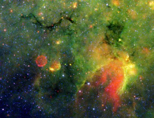 """Die """"Schlange"""" ist eine dunkle Staubwolke im Sternbild Schütze. (NASA / JPL-Caltech)"""
