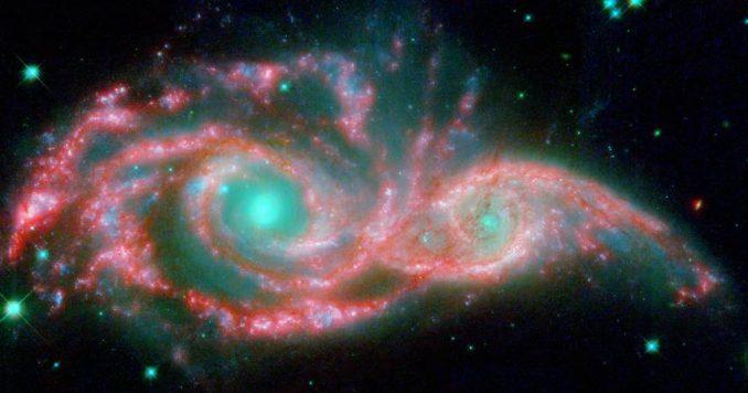 Die verschmelzenden Galaxien NGC 2207 und IC 2163, basierend auf Daten der Weltraumteleskope Spitzer und Hubble. (NASA, ESA / JPL-Caltech / STScI / D. Elmegreen (Vassar))