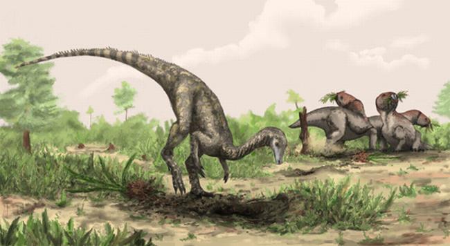 Künstlerische Darstellung von Nyasasaurus parringtoni, der entweder der früheste Dinosaurier oder der engste Verwandte der Dinosaurier ist. Hier ist er neben pflanzenfressenden Reptilien der Gattung Stenaulorhynchus abgebildet. ((c) Natural History Museum, London / Mark Witton)