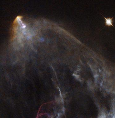 Das Herbig-Haro-Objekt HH 151, aufgenommen vom Weltraumteleskop Hubble. (ESA / Hubble & NASA. Acknowledgement: Gilles Chapdelaine)