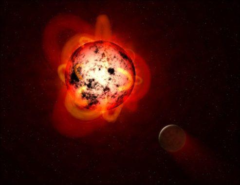 Diese Illustration zeigt einen roten Zwergstern, der von einem Exoplaneten umkreist wird. (Credits: NASA / ESA / G. Bacon (STScI))