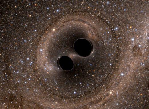 Diese Simulation zeigt die bevorstehende Kollision zweier Schwarzer Löcher, durch die Gravitationswellen produziert werden. (Credits: SXS)