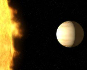 Künstlerische Darstellung des Exoplaneten WASP-39b neben seinem Zentralstern. (Credits: NASA, ESA, and G. Bacon (STScI))