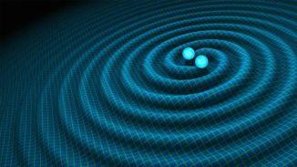 Künstlerische Darstellung der bevorstehenden Verschmelzung zweier Neutronensterne und der damit einhergehenden Gravitationswellen. (Credits: R. Hurt / Caltech-JPL)