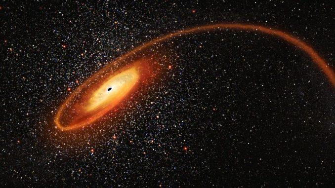 Illustration des mittelschweren Schwarzen Lochs beim Auseinanderreißen eines Sterns. (Credits: NASA, ESA and D. Player (STScI))