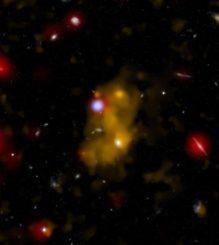 Ein Kompositbild einer Lyman-Alpha-Galaxie. Gelb markiert die Lyman-Alpha-Emission von Wasserstoff, Weiß zeigt die Galaxie, Rot die Infrarotansicht und Blau die Röntgenemissionen. (Credits: X-ray (NASA / CXC / Durham Univ. / D. Alexander et al.); Optical (NASA / ESA / STScI / IoA / S. Chapman et al.); Lyman-alpha Optical (NAOJ / Subaru / Tohoku Univ. / T. Hayashino et al.); Infrared (NASA / JPL-Caltech / Durham Univ. / J. Geach et al.))