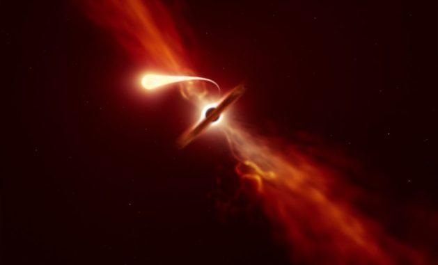 Diese Illustration zeigt einen Stern (im Vordergrund), der von einem supermassiven Schwarzen Loch (im Hintergrund) verschlungen und dabei spaghettifiziert wird. (Credit: ESO / M. Kornmesser)