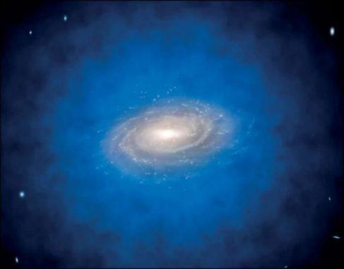 Künstlerische Darstellung einer Spiralgalaxie, die in eine größere Ansammlung von unsichtbarer Dunkler Materie eingehüllt ist, ein sogenannter Dunkle-Materie-Halo (blau). (Credits: ESO / L. Calçada / CC-BY 4.0)